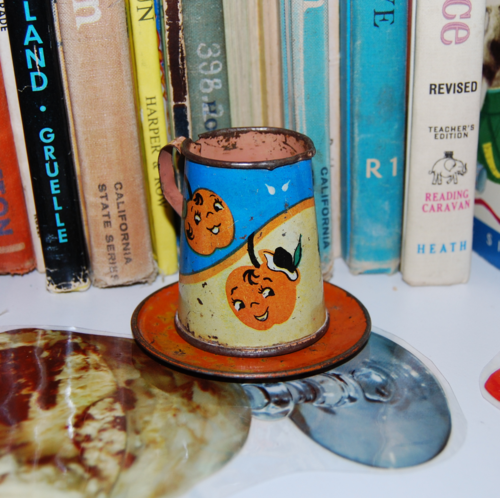 Tin orange pitcher