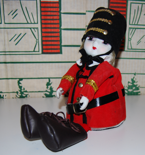 Vintage musical marching band doll