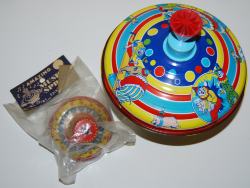 Vintage toy tin tops