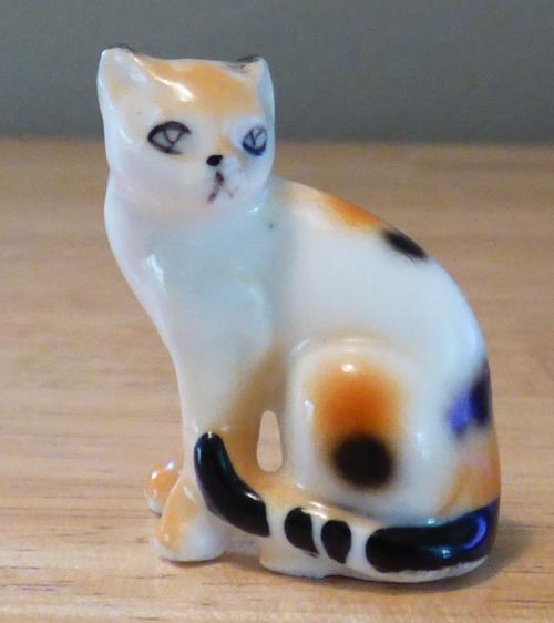 Miniature ceramic cat figurine