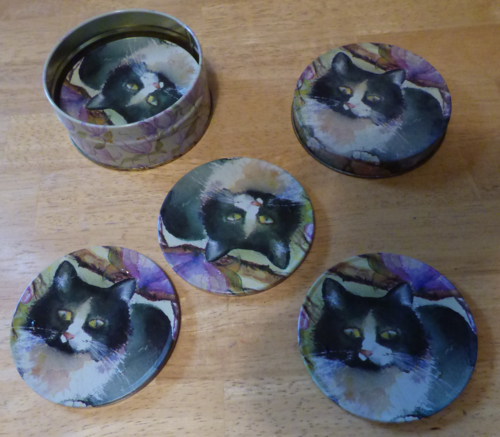 Tin kitty coasters