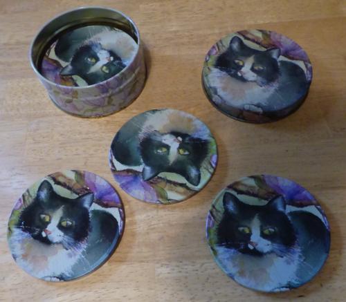 Tin kitty coasters