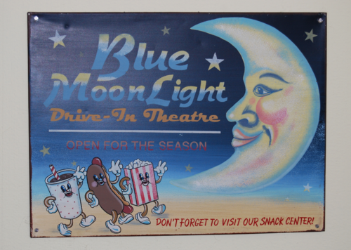 Blue moonlight drive in tin sign