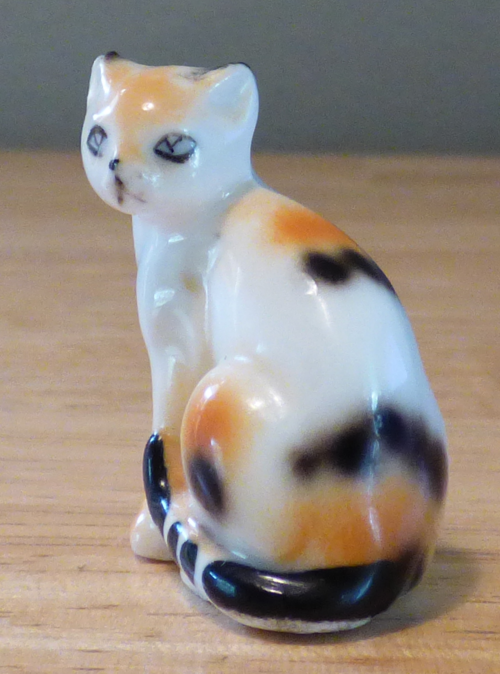 Miniature ceramic cat figurine 1