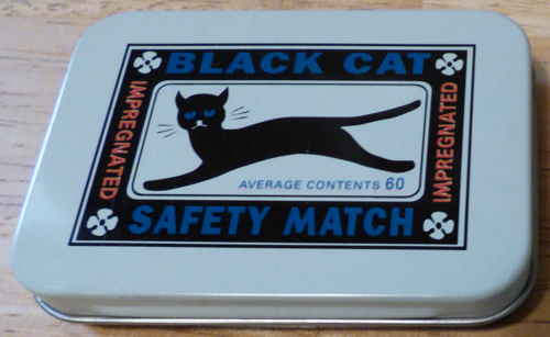 Black cat matches tin