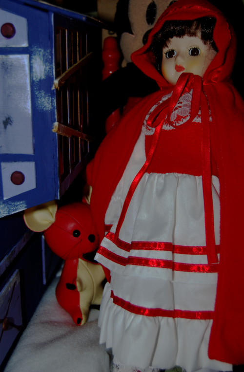 Musical wind-up little red riding hood doll