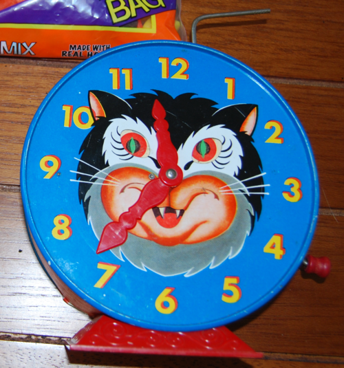 Mattel tin kitty clock x