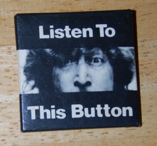 John lennon peace button