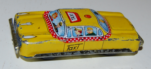 Vintage tin toy taxi