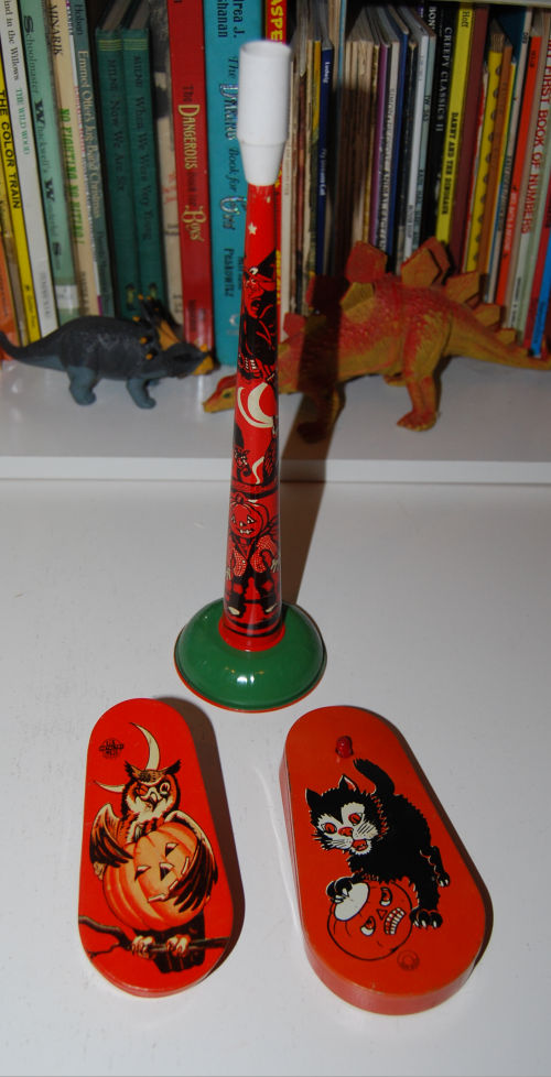 Vintage tin halloween noisemakers