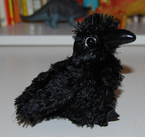 Folkmanis raven chick puppet