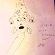 child with eyeball hat